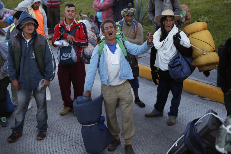 Central American migrants moving in a caravan toward the U.S. border sing Honduras' national anthem as they prepare to depart Guadalajara, Mexico, Tuesday, Nov. 13, 2018. Many say they are fleeing rampant poverty, gang violence and political instability primarily in the Central American countries of Honduras, Guatemala, El Salvador and Nicaragua. (AP Photo/Marco Ugarte)