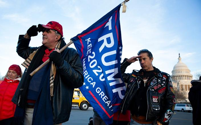 Trump supporters salute at a makeshift monument at the West Front of the US Capitol, for Ashli Babbitt - EPA