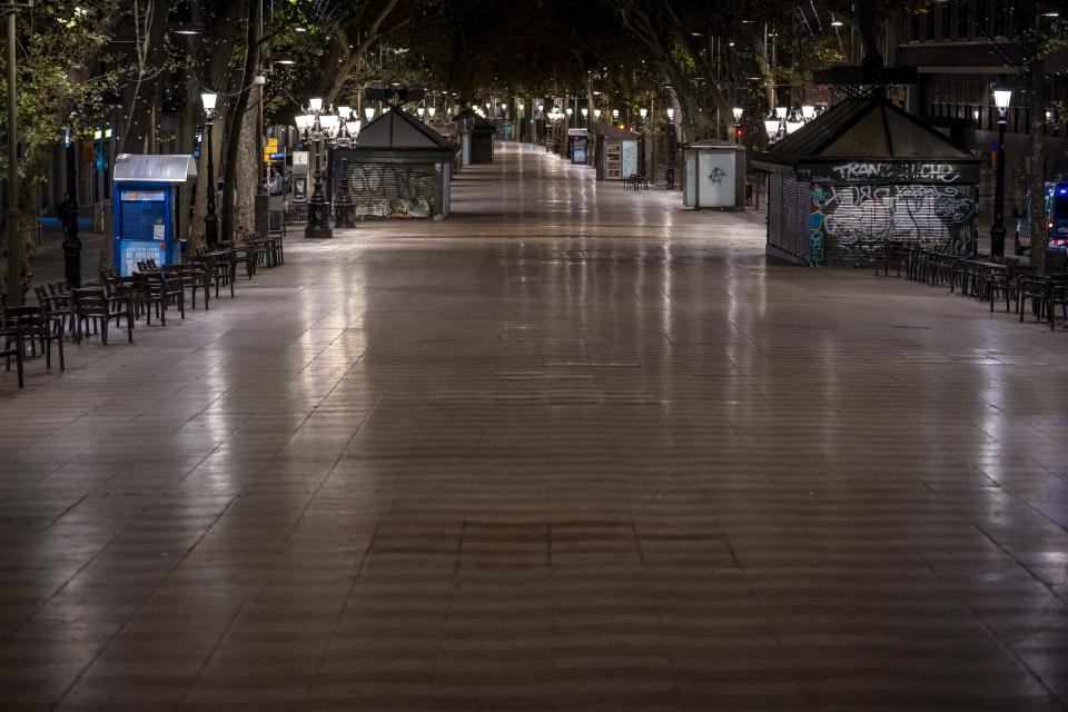Las Ramblas of Barcelona are pictured after curfew on Sunday, Oct. 25, 2020. Spain orders nationwide curfew to stem worsening outbreak. Spanish Prime Minister Pedro Sánchez has declared a second nationwide state of emergency in hopes of stemming a resurgence in coronavirus infections. (AP Photo/Emilio Morenatti)
