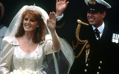 Prince Andrew and his bride Sarah Ferguson waving to crowds as they leave Westminster Abbey, London - Credit: PA