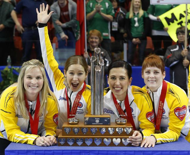 Manitoba skip Jennifer Jones (L-R) third Kaitlyn Lawes, second Jill Officer and lead Dawn McEwen pose with their trophy after defeating Alberta in their gold medal game during the Scotties Tournament of Hearts in Moose Jaw, Saskatchewan, February 22, 2015. REUTERS/Todd Korol (CANADA - Tags: SPORT CURLING)