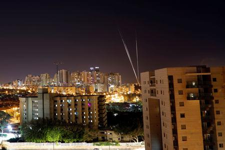 Streaks of light are pictured as rockets are launched from the Gaza Strip towards Israel, as seen from the Israeli city of Ashkelon May 4, 2019 REUTERS/ Amir Cohen