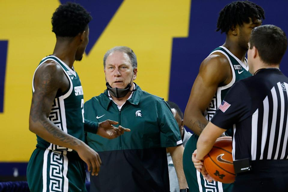 Michigan State coach Tom Izzo talks with guard Rocket Watts during the first half against Michigan on Thursday, March 4, 2021, at Crisler Center.