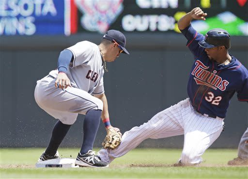 Minnesota Twins' Aaron Hicks, right, is tagged out by Cleveland Indians second baseman Asdrubal Cabrera while attempting to steal second in the third inning of a baseball game on Sunday, July 21, 2013, in Minneapolis. (AP Photo/Jim Mone)