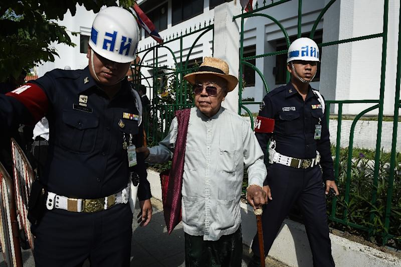 An elderly Thai historian who cast doubt on the official telling of a 16th century elephant duel was accused of insulting the monarchy, but a court threw out the case on Wednesday