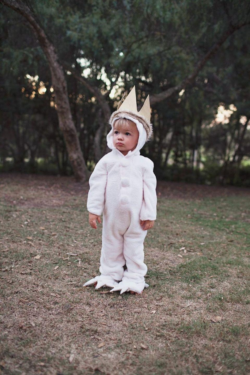 """<p>If there's anything better than a book character costume, it's one that's warm and cozy. Littles ones will look even cuter in this onesie.</p><p><strong>Get the tutorial at <a href=""""https://tellloveandparty.com/2014/09/tell-diy-where-the-wild-things-are-family-costume.html"""" rel=""""nofollow noopener"""" target=""""_blank"""" data-ylk=""""slk:Tell Love and Party"""" class=""""link rapid-noclick-resp"""">Tell Love and Party</a>.</strong></p><p><a class=""""link rapid-noclick-resp"""" href=""""https://go.redirectingat.com?id=74968X1596630&url=https%3A%2F%2Fwww.walmart.com%2Fsearch%2F%3Fquery%3Dcandy%2Bbucket&sref=https%3A%2F%2Fwww.thepioneerwoman.com%2Fholidays-celebrations%2Fg37014285%2Fbook-character-costumes%2F"""" rel=""""nofollow noopener"""" target=""""_blank"""" data-ylk=""""slk:SHOP CANDY BUCKETS"""">SHOP CANDY BUCKETS</a></p>"""