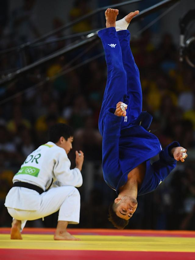 <p>Fabio Basile of Italy performs a flip as he celebrates winning the gold medal against Baul An of Korea during the Men's -66kg gold medal final on Day 2 of the Rio 2016 Olympic Games at Carioca Arena 2 on August 7, 2016 in Rio de Janeiro, Brazil. (Photo by Laurence Griffiths/Getty Images) </p>