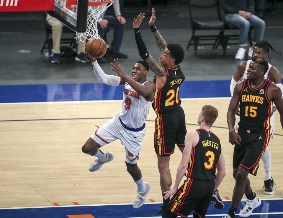 New York Knicks guard RJ Barrett (9) drives for a layup against Atlanta Hawks forward John Collins (20) during the third quarter of an NBA basketball game Wednesday, April 21, 2021, in New York. (Wendell Cruz/Pool Photo via AP)