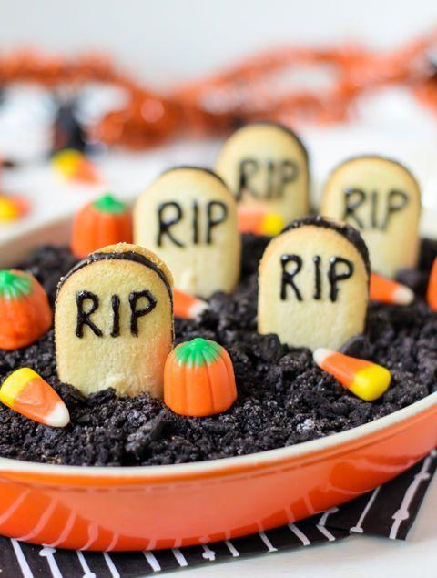 """<p>Cream cheese, cocoa, and lots of candy make this dip worth your while. It also doubles as table décor!</p><p><strong>Get the recipe at <a href=""""http://www.wellplated.com/chocolate-cheesecake-dip/?crlt.pid=camp.MVFfhAjGoXte0"""" rel=""""nofollow noopener"""" target=""""_blank"""" data-ylk=""""slk:Well Plated"""" class=""""link rapid-noclick-resp"""">Well Plated</a></strong>.</p><p><strong><a class=""""link rapid-noclick-resp"""" href=""""https://go.redirectingat.com?id=74968X1596630&url=https%3A%2F%2Fwww.walmart.com%2Fip%2FThe-Pioneer-Woman-5-Piece-Prep-Set-Measuring-Bowls-Cup%2F55467843&sref=https%3A%2F%2Fwww.thepioneerwoman.com%2Ffood-cooking%2Fmeals-menus%2Fg32110899%2Fbest-halloween-desserts%2F"""" rel=""""nofollow noopener"""" target=""""_blank"""" data-ylk=""""slk:SHOP MEASURING CUPS"""">SHOP MEASURING CUPS</a></strong></p>"""