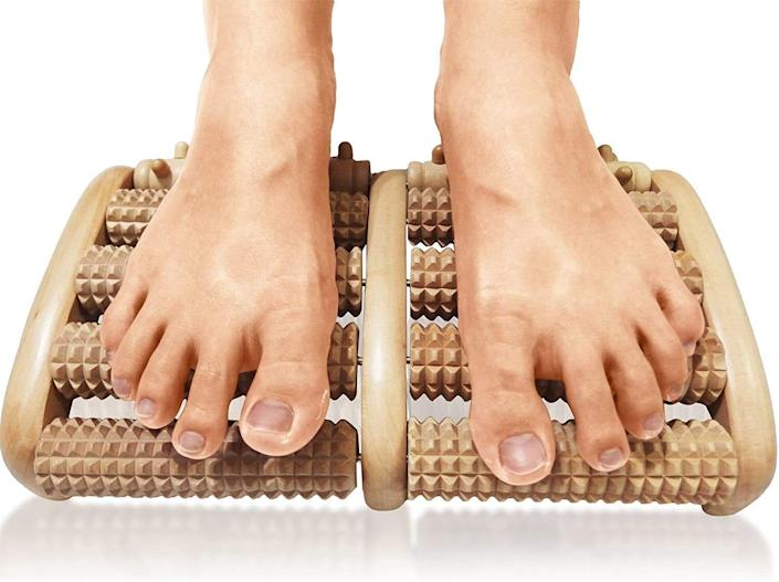 "If you're on your feet all the time, you'll get sweet, sweet relief from this massager with acupressure nubs. No more asking each other for foot rubs. <br /><br /><strong>Promising review:</strong> ""I've been having so many issues with my feet the last few years. My feet hurt so bad, it's made me become a hermit. I've had tendinitis in both and now plantar fasciitis. I <strong>get foot cramps all the time. After just one day with this under my desk at work, I feel a huge difference. My feet no longer feel tight and painful.</strong> They feel tingly — in a good way. I look forward to being able to go for a walk and not have to rest along the way. I know it's meant for feet but I may try it out on my calves. I also love that it's small, looks nice and doesn't slide around. I highly recommended this for anyone, foot issues or not, if you sit a lot. Nice way to keep the blood flowing when stuck at a desk."" — <a href=""https://amzn.to/3mNvfyo"" target=""_blank"" rel=""noopener noreferrer"">Vanessa Thomas</a><br /><br /><a href=""https://www.amazon.com/gp/customer-reviews/RX2BTAIJSVQBB?tag=bfheather-20&ascsubtag=5312233%2C7%2C33%2Cd%2C0%2C0%2Cgoogle%2C962%3A1%3B901%3A2%3B900%3A2%3B974%3A2%3B975%3A2%3B982%3A2%2C33455%2C0"" target=""_blank"" rel=""nofollow noopener noreferrer"" data-skimlinks-tracking=""5312233"" data-vars-affiliate=""Amazon"" data-vars-href=""https://www.amazon.com/gp/customer-reviews/RX2BTAIJSVQBB?tag=bfheather-20&ascsubtag=5312233%2C7%2C33%2Cmobile_web%2C0%2C0%2C33455"" data-vars-keywords=""cleaning,fast fashion"" data-vars-link-id=""33455"" data-vars-price="""" data-vars-product-id=""15932520"" data-vars-retailers=""Amazon""></a><strong>Get it from Amazon for <a href=""https://amzn.to/3e4bbDS"" target=""_blank"" rel=""noopener noreferrer"">$17.95+</a> (available in two styles).</strong>"