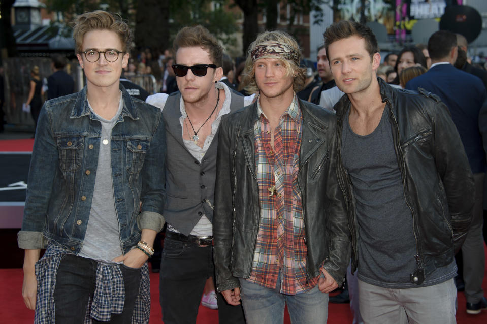 McFly arrive for the UK Premiere of 'One Direction: This Is Us 3D' at a central London cinema, Tuesday, Aug. 20, 2013. (Photo by Jonathan Short/Invision/AP)