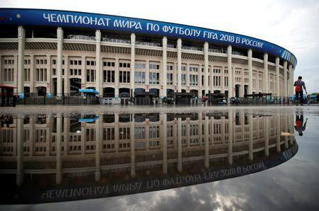 Luzhniki stadium is reflected in a puddle in Moscow, Russia, June 30, 2018. REUTERS/Christian Hartmann