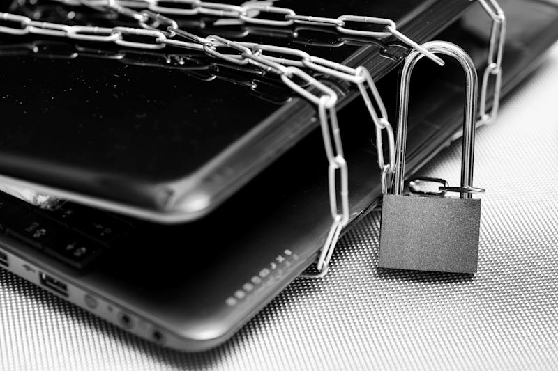 A laptop chained with a padlock.