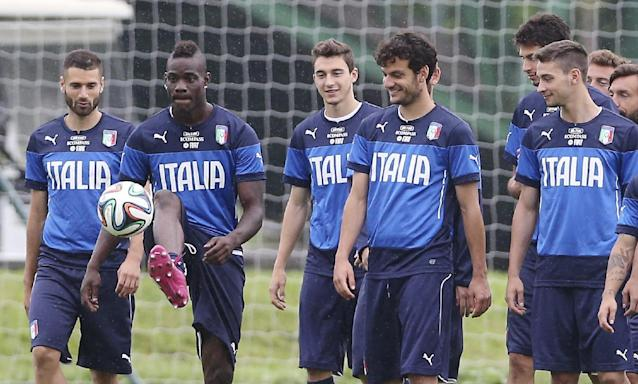 Italy's Mario Balotelli, second from left, controls the ball during a training session in Mangaratiba, Brazil, Tuesday, June 10, 2014. Italy plays in group D of the 2014 soccer World Cup. (AP Photo/Antonio Calanni)