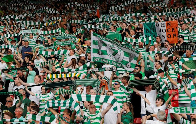 Soccer Football - Scottish Cup Final - Celtic vs Motherwell - Hampden Park, Glasgow, Britain - May 19, 2018 Celtic fans celebrate after winning the Scottish Cup REUTERS/Russell Cheyne