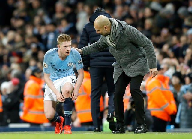 Kevin De Bruyne, left, will be absent for several weeks (Martin Rickett/PA)