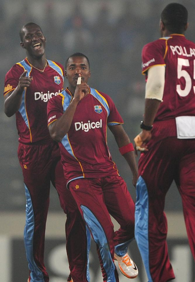 West Indies cricket captain Darren Sammy (L) and Darren Bravo (C) react after the dismissal of Bangladesh cricketer Mominul Haque during the fourth one day international cricket match between Bangladesh and the West Indies at The Sher-e-Bangla National Cricket Stadium in Dhaka on December 7, 2012. AFP PHOTO/ Munir uz ZAMAN