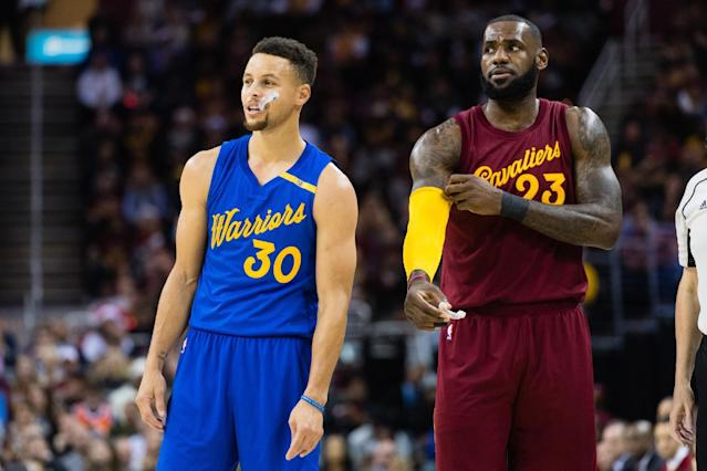Stephen Curry (L) and LeBron James in a December 2016 game. (Getty)