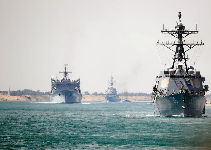 In this May 9, 2019, photo released by the US Navy, the Abraham Lincoln Carrier Strike Group transits the Suez Canal. The carrier group passed through the Suez Canal, Egyptian authorities said, as the group heads towards the Gulf amid rising tensions between Washington and Tehran.