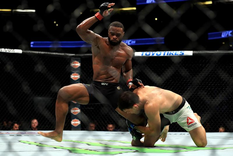 Tyron Woodley (black shorts) fights Demian Maia of Brazil in the Welterweight title bout during UFC 214 at Honda Center on July 29, 2017 in Anaheim, California.