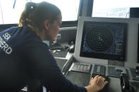 Carmen McGregor, second officer of the Ocean Warrior, checks the radar system on July 18, 2021, as part of the ship's 18-day voyage to observe up close the activities of the Chinese distant water fishing fleet off the west coast of South America. (AP Photo/Joshua Goodman)