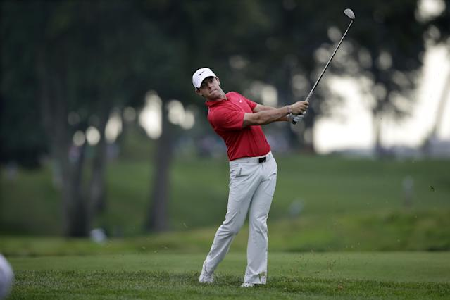 Rory McIlroy, of Northern Ireland, hits a fairway shot on the 13th hole during the first round of play at The Barclays golf tournament Thursday, Aug. 21, 2014, in Paramus, N.J. (AP Photo/Mel Evans)