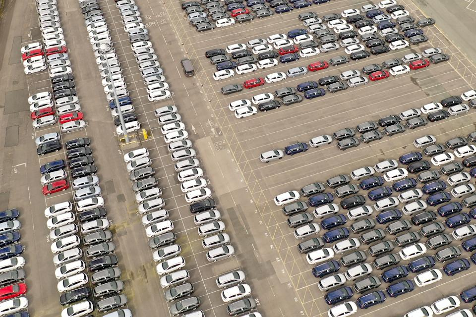 Recently assembled Vauxhall vehicles are stored in the distribution yard at the Vauxhall car factory on March 17, 2020 in Ellesmere Port, England. The carmaker's parent company, PSA Group, said its plants would remain closed through March 27, citing a drop in demand and supply-chain disruption due to the COVID-19 outbreak. (Photo by Christopher Furlong/Getty Images)