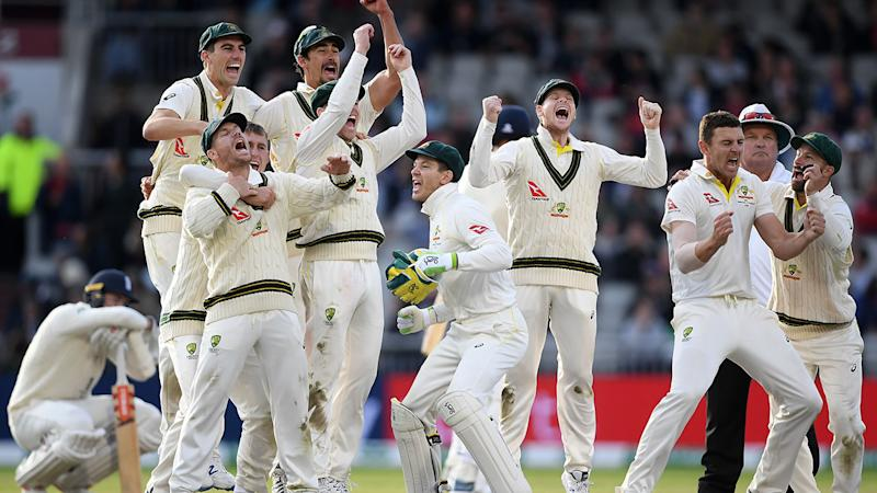 The Aussies celebrate their victory. (Photo by Alex Davidson/Getty Images)