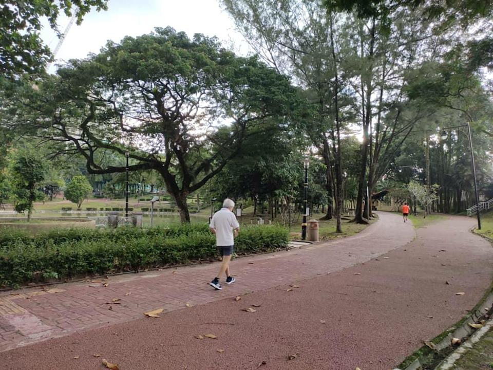 Joggers jogging at Taman Tasik Permaisuri on the first day of CMCO May 4, 2020. — Picture by Kenneth Tee