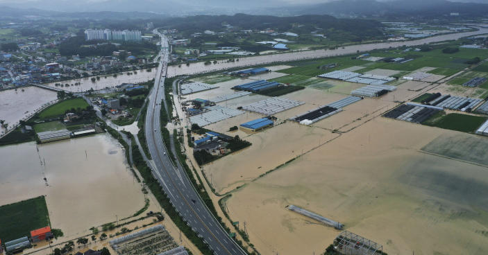 Agricultural lands are inundated with flood waters after heavy rains in Anseong, South Korea, Sunday, Aug. 2, 2020. South Korean Meteorological Administration issued a warning of heavy rain for Seoul and central area. (Hong Ki-won/Yonhap via AP)