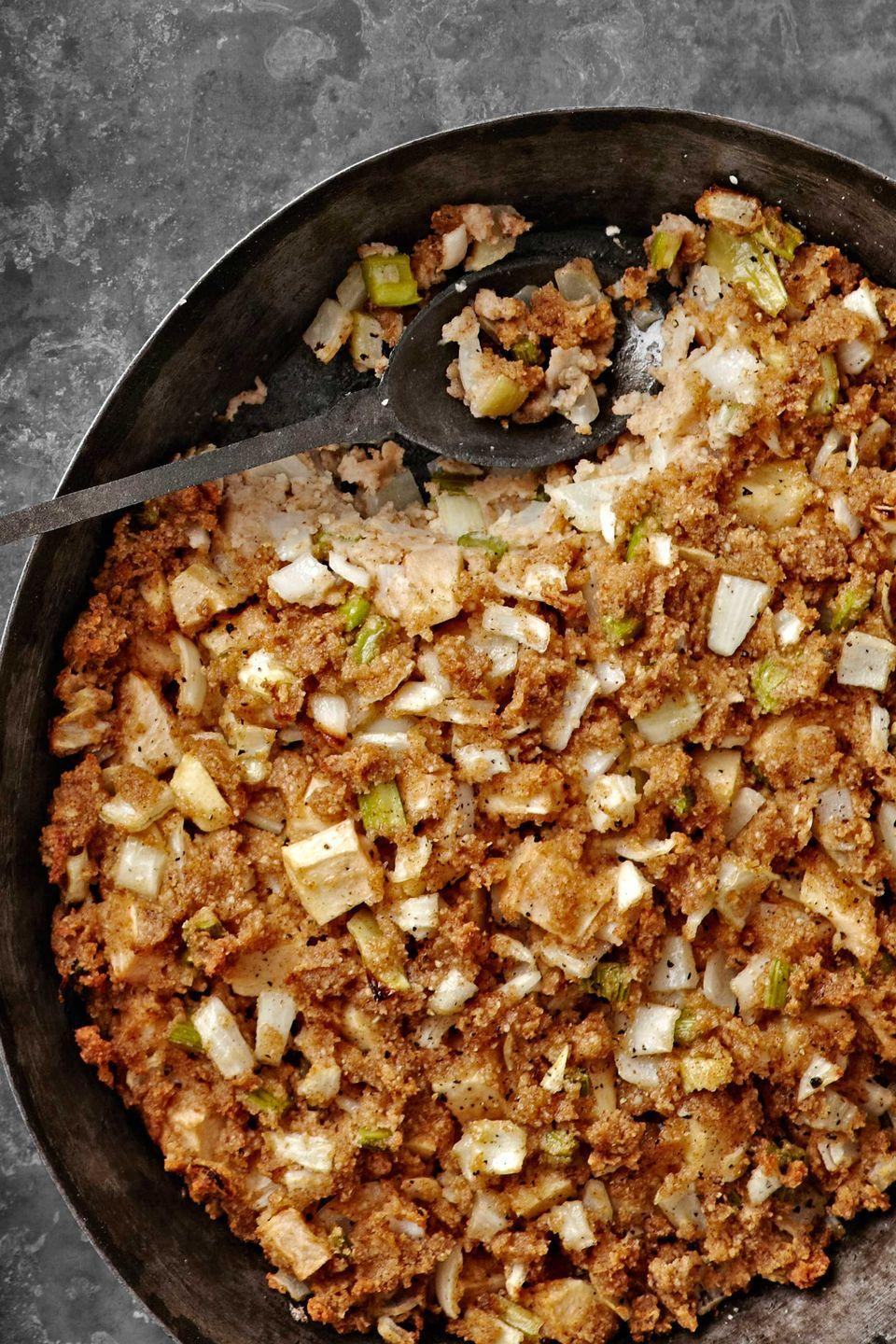 "<p class=""imageContent"">Matzo meal and chicken broth are added together slowly to ensure this stuffing is deliciously moist. Apples and cinnamon impart a surprising hint of sweetness.<strong><br></strong></p><p class=""imageContent""><strong><a href=""https://www.countryliving.com/food-drinks/recipes/a4230/edythe-newmans-matzo-stuffing-recipe-clv1112/"" rel=""nofollow noopener"" target=""_blank"" data-ylk=""slk:Get the recipe"" class=""link rapid-noclick-resp"">Get the recipe</a>.</strong></p>"