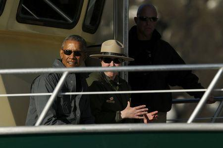 U.S. President Barack Obama (L) takes a boat tour of Kenai Fjords National Park in Seward, Alaska September 1, 2015. REUTERS/Jonathan Ernst