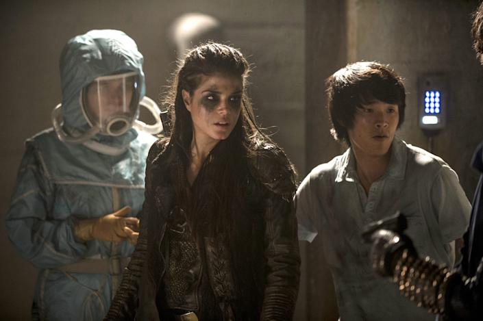 Eve Harlow as Maya, left, Marie Avgeropoulos as Octavia, and Chris Larkin as Monty on 'The 100.'