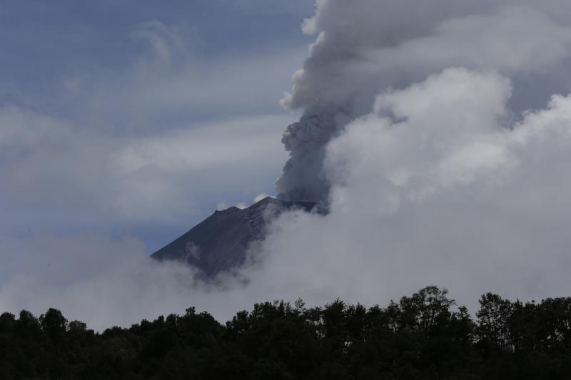 A plume of ash and steam rises from the Popocatepetl volcano during a brief view from cloud cover as seen from the town of Santiago Xalizintla, Mexico, Saturday, July 6, 2013. Just east of Mexico City, the volcano has spit out a cloud of ash and vapor 2 miles (3 kilometers) high over several days of eruptions. Mexico's National Center for Disaster Prevention raised the volcano alert from Stage 2 Yellow to Stage 3 Yellow, the final step before a Red alert, when possible evacuations could be ordered. (AP Photo/Dario Lopez-Mills)