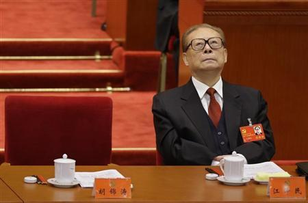 China's former President Jiang looks up while President Hu Jintao gives his speech during the opening ceremony of 18th National Congress of the Communist Party of China at the Great Hall of the People in Beijing