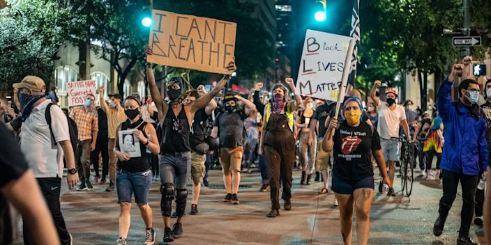On Sunday, people marched in the streets of downtown Austin following a vigil for Garrett. Foster