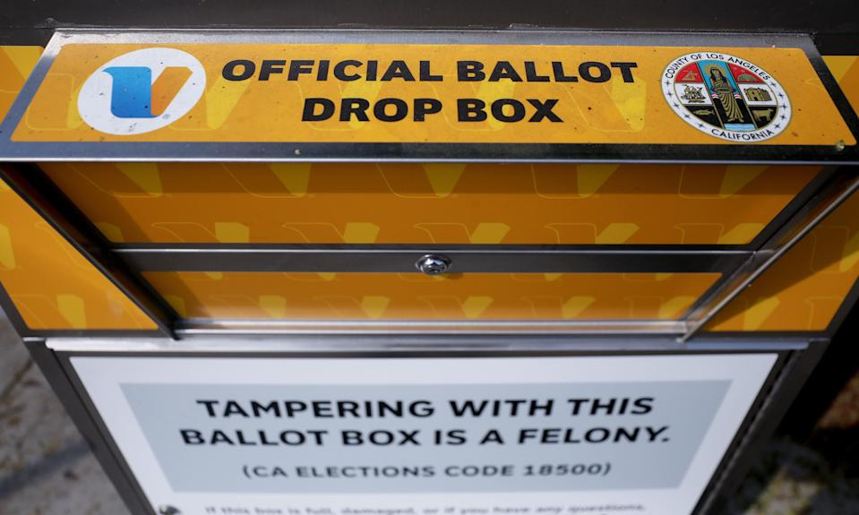 An official mail-in ballot drop box is posted outside of a library ahead of Election Day on October 5, 2020 in Los Angeles, California. One of these boxes was set on fire, in an incident officials are investigating as arson.