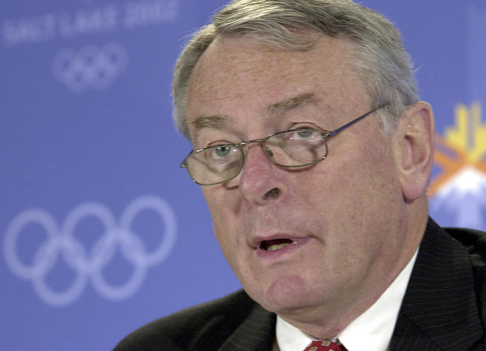FILE - In this Monday Feb. 4, 2002 file photo, World Anti-Doping Agency Chairman Dick Pound speaks about the agency's report during a press conference at the Winter Olympic media center in Salt Lake City. A sports organization battered by an unfolding corruption scandal with the FBI leading the investigation was the crisis facing the International Olympic Committee in the late 1990s. The IOC is being held up as a model for FIFA to follow as its tries to dig itself out of the biggest corruption scandal in its 111-year history. (AP Photo/Elaine Thompson, file)