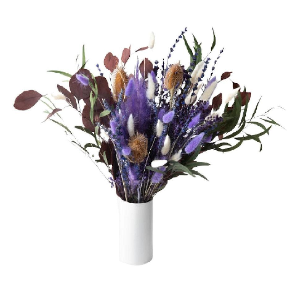 """Warm up her space with this magical <a href=""""https://www.glamour.com/gallery/best-dried-flowers?mbid=synd_yahoo_rss"""" rel=""""nofollow noopener"""" target=""""_blank"""" data-ylk=""""slk:dried flower bouquet"""" class=""""link rapid-noclick-resp"""">dried flower bouquet</a>, featuring purple thistle, lavender, pampas grass, and baby soft bunny tails. $95, UrbanStems. <a href=""""https://urbanstems.com/products/flowers/the-juneau/FLRL-K-00448.html"""" rel=""""nofollow noopener"""" target=""""_blank"""" data-ylk=""""slk:Get it now!"""" class=""""link rapid-noclick-resp"""">Get it now!</a>"""