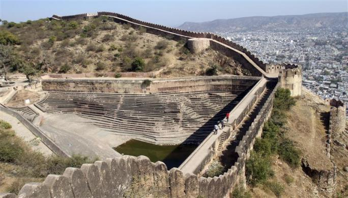 Tourists walk on a footway of the step well of Nahargarh fort in Jaipur, capital of India's desert state of Rajasthan January 23, 2012. Nahargarh fort, one of the major tourist attractions of the city, was built by Sawai Raja Jai Singh in 1734.