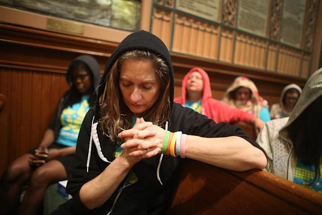 NEW YORK, NY - JULY 14: People wear hoodies during services honoring Trayvon Martin at Middle Collegiate Church in Manhattan on July 14, 2013 in New York City. George Zimmerman was acquitted of all charges in the shooting death of Martin July 13 and some congregants wore hoodies during the service to honor Martin. (Photo by Mario Tama/Getty Images)