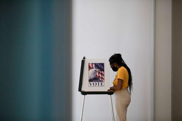 PHOTO: A person votes in the upcoming presidential elections as early voting begins in Ann Arbor, Mich., Sept. 24, 2020. (Emily Elconin/Reuters)