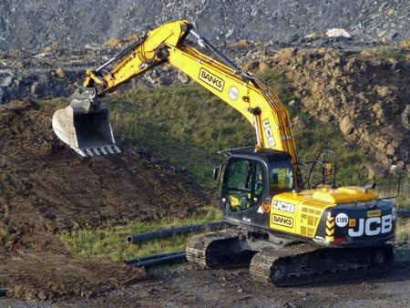 FILE PHOTO: A digger at the Banks Group Shotton open cast coal mine in Northumberland, November 11, 2016. Picture taken November 11, 2016. REUTERS/Barbara Lewis/File Photo
