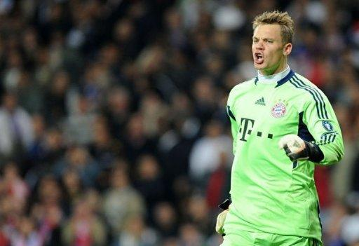 Manuel Neuer celebrates after saving a penalty