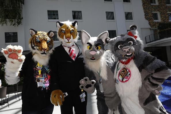 Participants dressed as cuddly animals arrive for the annual Eurofurence 'furries' gathering at the Estrel hotel on August 22, 2018 in Berlin, Germany. Eurofurence attracts furry fandom enthusiasts from across the globe for four days of anthropomorphic fun. (Photo by Michele Tantussi/Getty Images)