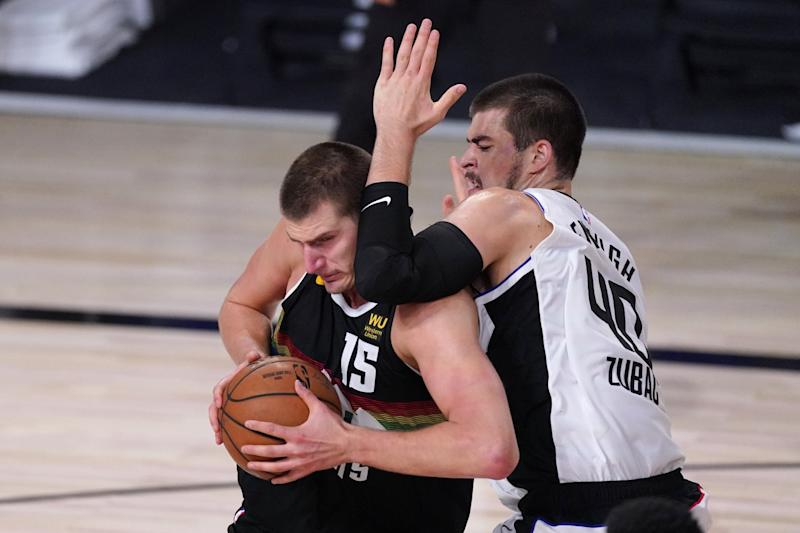 Denver Nuggets' Nikola Jokic tries to get past Clippers' Ivica Zubac.