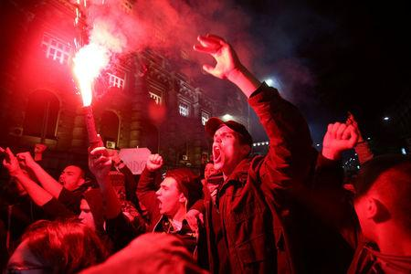 Protesters take part in a demonstration against the overwhelming victory of Prime Minister Vucic in Serbia's presidential election in Belgrade