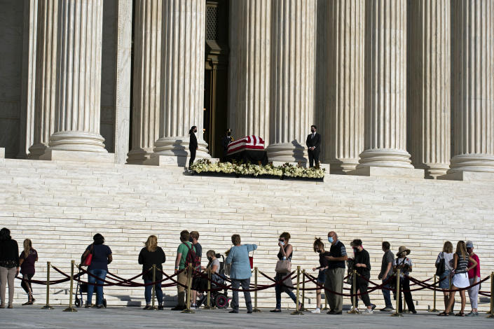 Mourners pay their respects as Justice Ruth Bader Ginsburg lies in repose under the Portico at the top of the front steps of the U.S. Supreme Court building on Wednesday, Sept. 23, 2020, in Washington. Ginsburg, 87, died of cancer on Sept. 18. (AP Photo/Jose Luis Magana)