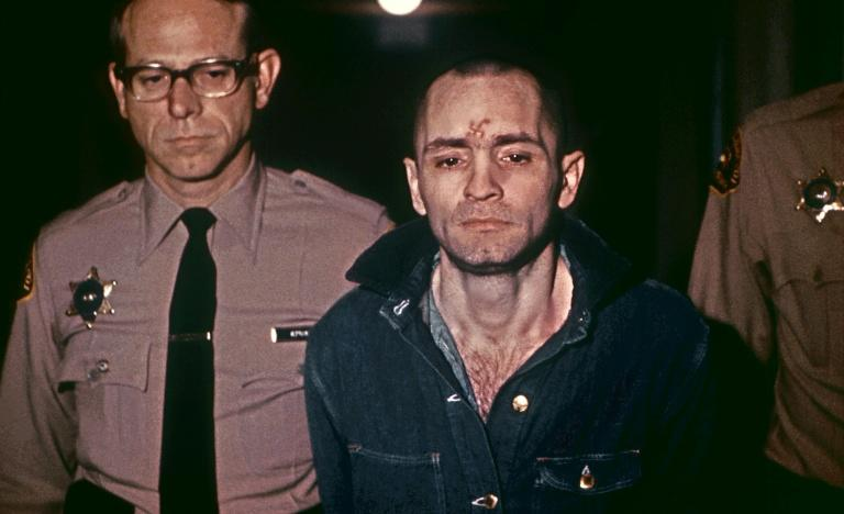 Sullen-faced Charles Manson is escorted to hear his death sentence, passed by the court, in Los Angeles, on March 29, 1971