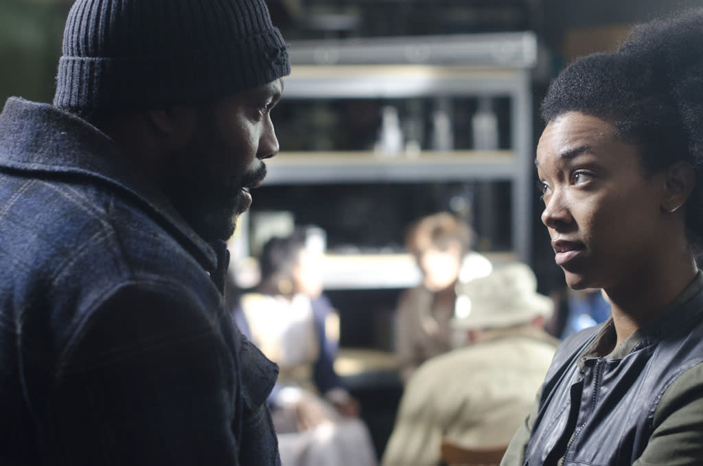 "Tyreese (Chad Coleman) and Sasha (Sonequa Martin-Green) in ""The Walking Dead"" Season 3 Finale, ""Welcome to the Tombs."""